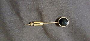 Men's lapel pin, gold and black, tuxedo style.