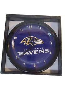 Baltimore Ravens NFL Football Wall Clock Black Rim Clock- battery operated.