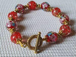 bracelet perles de murano milflori rouge , et flocon rouge p int p or