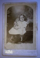 Cabinet Photo of Young Girl Holding Doll from the early 1900's or earlier
