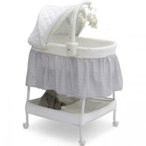Baby Gliding Bassinet Electronic Mobile Arm w Spinning Bear Toys Storage Basket