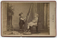CABINET CARD CHILD AT PAINTERS EASEL PAINTING A PORTRAIT.