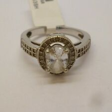 Sterling silver ring with synthetic diamond centre and surrounding marcasites