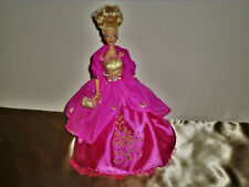 Barbie doll with Evening Wear Magenta Gold Gown.