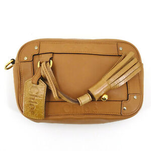 Chloé All Leather Pouch Clutch Bag with Tassles in Brown