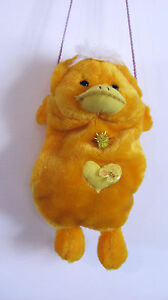 A HANDMADE BAG PURSE FOR A GIRL IN A  YELLOW FUR DUCK SHAPE HANDS WARMER TOTE