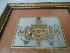 Fine looking mystery gold coloured enamelled jewelled panel with display case