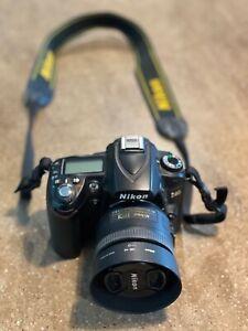 Nikon D90 DSLR camera and AF-S NIKKOR 35mm 1.8G lens with UV filter.