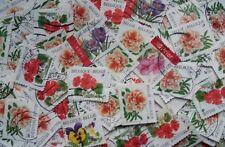 BELGIQUE Lot de +250 timbres fleurs oblitérés (environ 50 g)