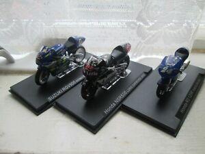 2 HONDA AND SUZUKI  MOTO GP BIKES 1-24 SCALE MOTORCYCLE MODELS