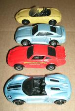 Four 1/64 Scale Hot Wheels Porsche Diecast Cars - Boxster 959 918 Spyder 930 911
