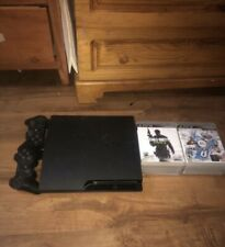 Sony PlayStation 3,  320GB Charcoal Black Console With 2 Controllers And 7 Games