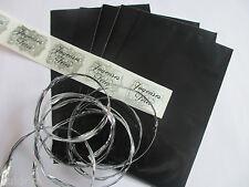 pochettes cadeaux-sac-papier cadeaux-emballage-ruban-bolduc-noir