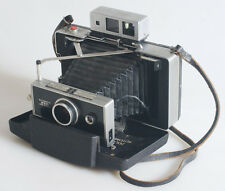 POLAROID 250 LAND CAMERA WITH MANUAL/COLD SLIDES/STRAP