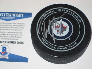TYLER MYERS Signed Winnipeg JETS Official GAME Puck w/ Beckett COA