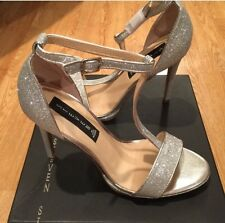 FLASH SALE!! Gorgeous Steve Madden Hot To Trot Silver T Strap Heels Size 7.5