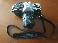 Silver Canon AE-1 Program 35mm SLR Camera Bundle -with 3 lenses and manual.
