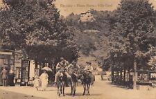 7604) RECOARO (VICENZA) PIAZZA NUOVA, EDICOLA, UOMINI SU MULI E PASSANTI VG 1916