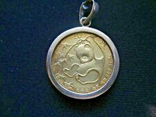 1985 $50 GOLD PANDA WITH 14 KT BEZEL