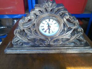 Antique style Chand carved wooden mantel clock with quartz movement.