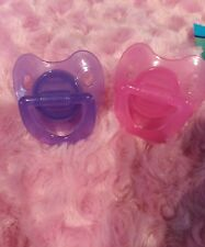 TWO MAGNETIC PACIFIERS TO FIT BABY ALIVE DOLLS SHOWN ORANGE AND GREEN PACIFIERS