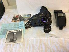 Nikon EM Camera With Series E 50mm 1.8 Lens, SB-E Flash, Owner Manuals, Carrot