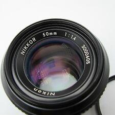 Nikon / Nikkor 50mm F/1.4 Non Ai Camera lens W/ Nikon filter Very Nice