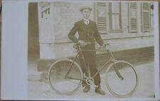 1910 Realphoto Postcard: Man with Bicycle - Chocolat Menier Advertising Sign