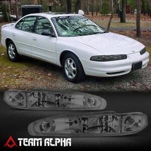 Fits 1998-2002 Oldsmobile Intrigue [Chrome/Smoke] Crystal Corner Headlight Lamp