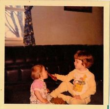 Old Vintage Photograph Little Boy Feeding Baby Chocolate Easter Bunny