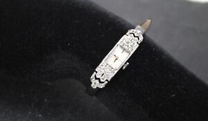 Damenuhr, Gehäuse Platin 950  (ca.um 1920-30)Handaufzug, gefaßt mit 22 Diamanten