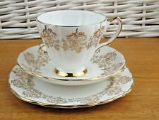 Crown Royal Bone China Tea Cup Saucer Plate Trio  Gold Chintz Ivory