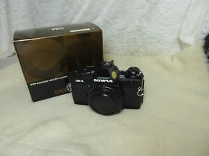 Olympus OM-4 Black 35mm SLR Camera Boxed Excellent from a collectors nr mint