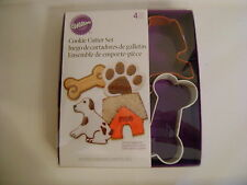 New listing Wilton Metal 4pc Cookie Cutter Set / Dog, Paw, Doghouse, Milkbone/New / Sealed