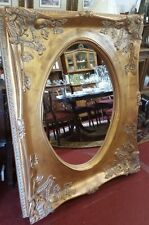 Large Oval Mirror in a Rectangular Gold Frame  57''x 46.75'' Ornate corners
