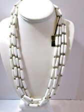 FOUR STRAND CYLINDER SHAPE BEADS GOLD TONE SPACERS WHITE LUCITE WITH TAG NOS