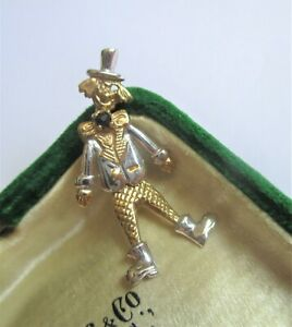 Small 9ct Yellow & White Gold articulated clown pendant. Sapphire Hallmarked