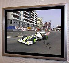 Jenson Button F1 Brawn campeón del mundo de lienzo enmarcado A3 plata grande firmado.