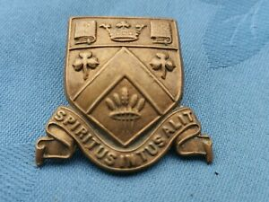 The Clifton College Bristol Officers Training Corp cap badge.