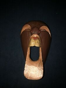 New hand carved brown wooden screaming face wall hanging