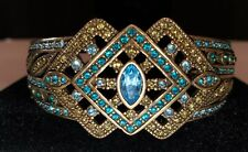 Signed Heidi Daus Bronze Hinged Bracelet with Blue & Gold Swarovski Crystals