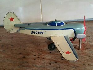 VNTG. TOY DOSAAF AIRPLANE TIN WIND UP AEROFLOT JET AIRCRAFT RUSSIA CCCP AND KEY