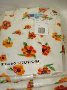 VINTAGE 1980,S  WOMENS SIZE SMALL TO MEDIUM WHITE WITH ORANGE  FLORAL TOP