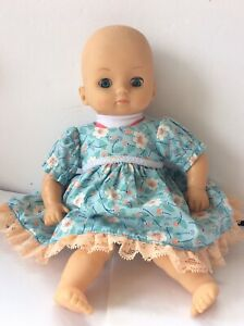 """2009  Cititoy Baby Doll Vinyl 13.5"""" Baby Doll blue  Eyes beautiful baby clothes"""