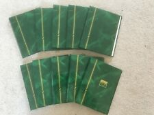 Ten green  slip-in photo albums 7 x 5 inches