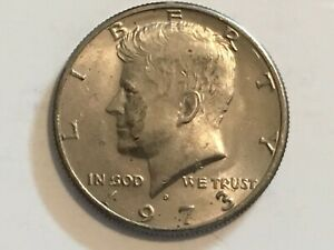 1973 D Kennedy Half Dollar error coin machine doubling dollar, america & feather