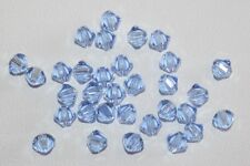 50 Cristalli SWAROVSKI ELEMENTS ORIGINALI 4mm BICONE BICONO BEAD LIGHT SAPPHIRE