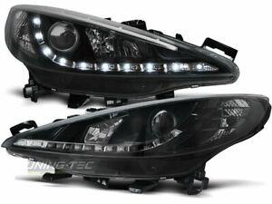 Coppia di Fari Anteriori LED DRL Look per Peugeot 207 2006-2009 Daylight Neri IT