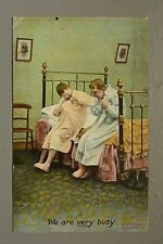 R&L Postcard: Comic, Bamforth We are Very Busy, Men in Nightgowns, Bedroom