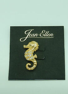 Pin/Broach-SEAHORSE--gold toned -clear sparkly stones